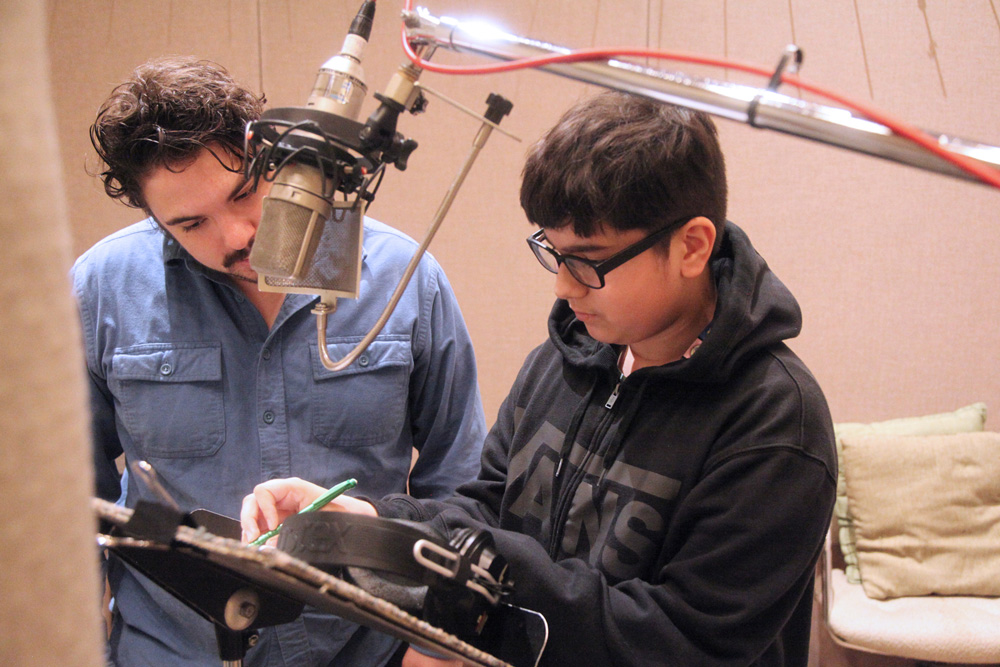 Denny student in the studio with engineer Daniel Guenther