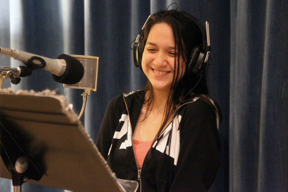 Denny student records her poem in the studio