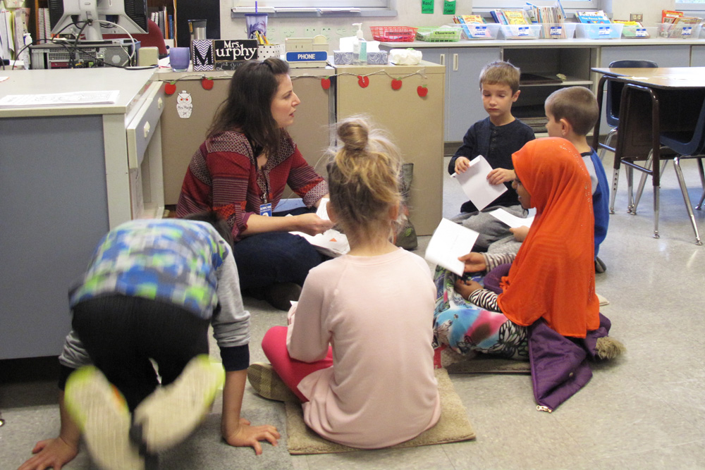 Jack Straw voice coach Alyssa Keene works with Olympic View students in the classroom