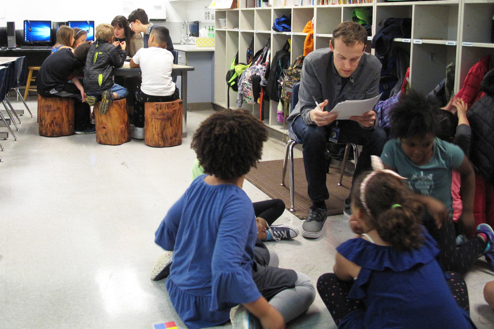 Jack Straw teaching artists work with Olympic View students in the classroom