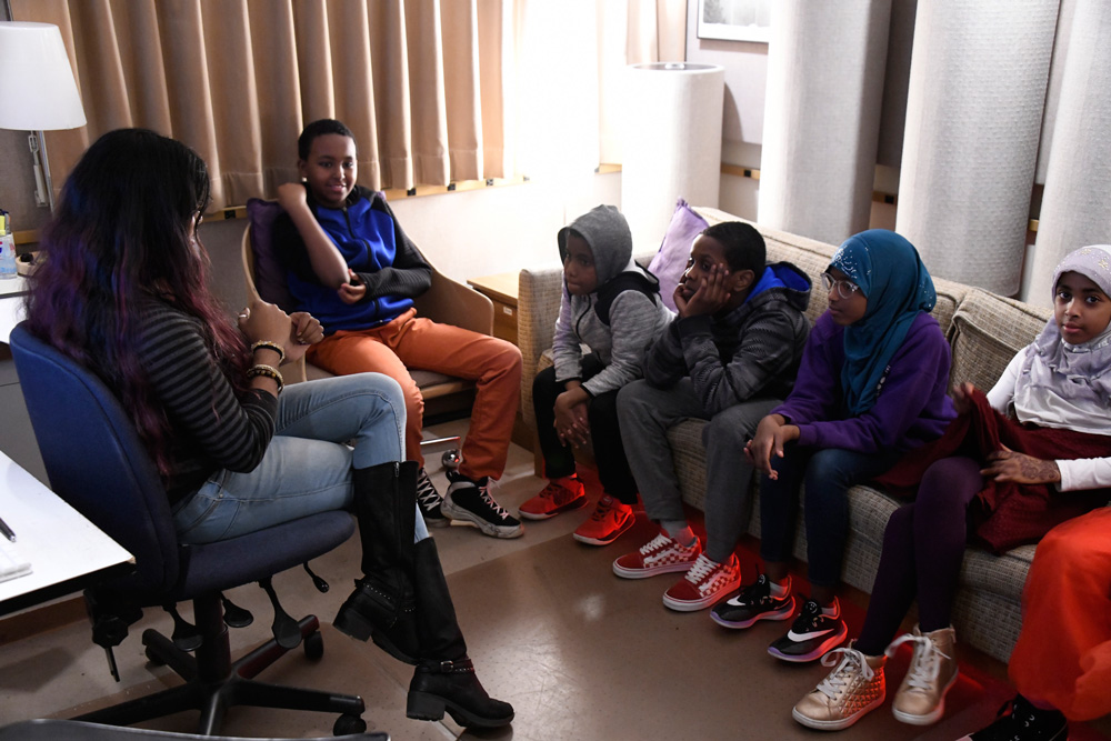 Students listening back in the control room with engineer Ayesha Ubayatilaka