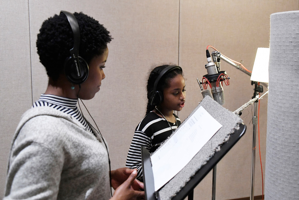 A student records her poem with vocal coach Claudine Mboligikpelani Nako