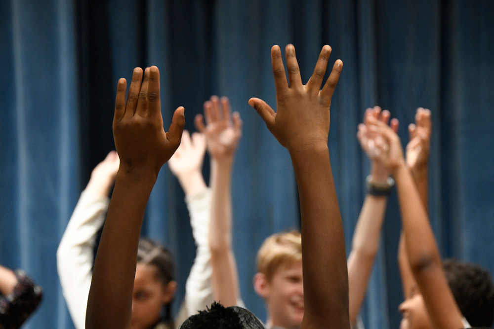 Students' hands as they warm up for recording