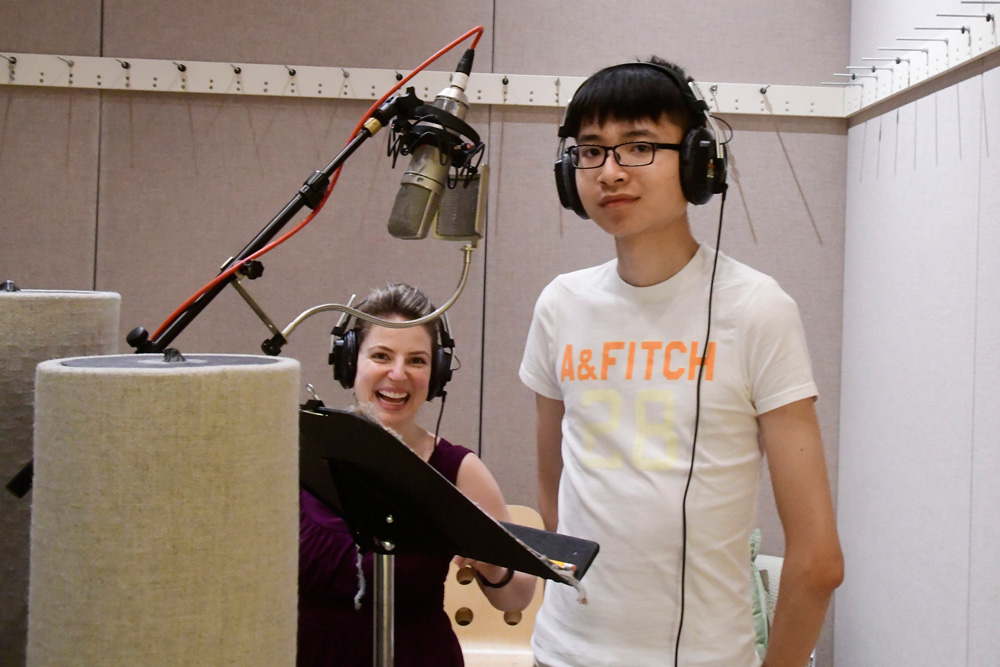 World School student prepares to record his piece in the studio with Jack Straw voice coach Alyssa Keene