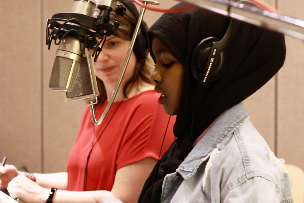 World School student records her narration in the studio with Jack Straw voice coach Alyssa Keene